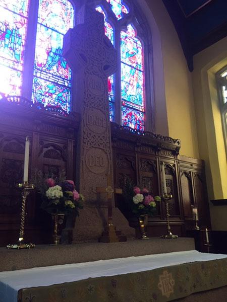 Stone cross inside church